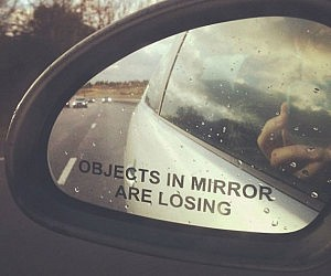 objects-in-mirror-are-losing-car-sticker-300x250